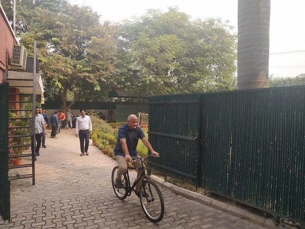 Delhi Deputy Chief Minister Manish Sisodia cycles to work on Monday