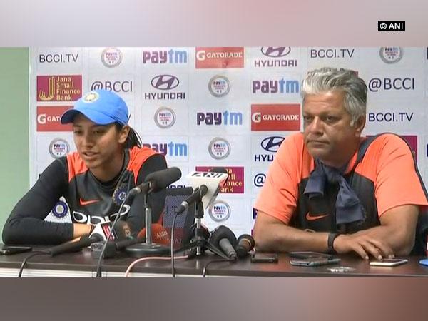 Indian Women's team stand in skipper Smriti Mandhana and coach WV Raman (ANI Picture)