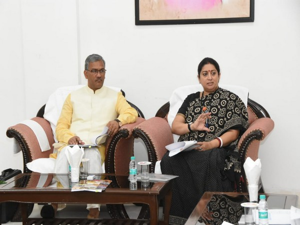 Women and Child Development Minister Smriti Zubin Irani and Chief Minister Trivendra Singh Rawat on Tuesday at Chief Minister's residence. Photo/ANI