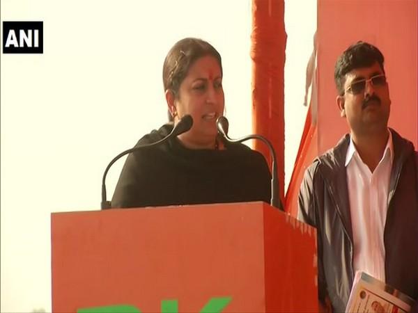Union Minister Smriti Irani addressing a public meeting in Pratapgarh on Thursday. Photo/ANI