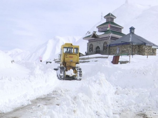 Snow clearing operation at the Mughal Road on Tuesday.