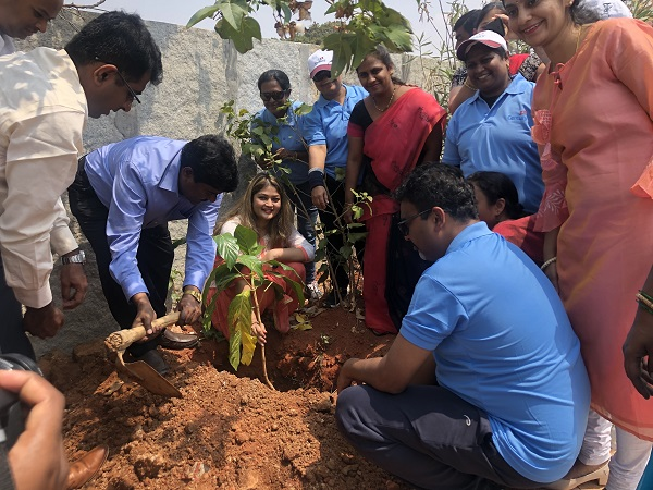 Volunteers planting trees as part of social forestry programme at the village