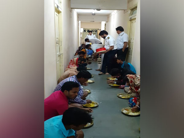 Villagers being served food at the Sagar Pilot Station of the Kolkata Port Trust on Sunday. Photo/ANI