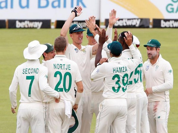 South African team celebrating after winning the Test by 107 runs.