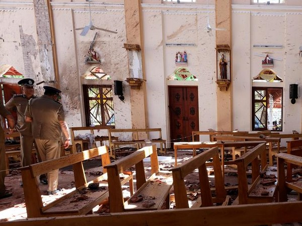 Sri Lankan police investigating the bomb site following the coordinated bomb blasts on Sunday
