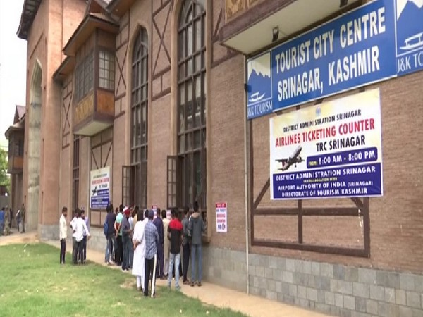 People queue at air ticket counters in Srinagar on Thursday. Photo/ANI