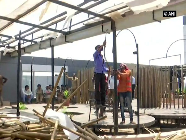 SMC workers tearing down a restaurant in west zone, Surat on Monday. Photo/ANI