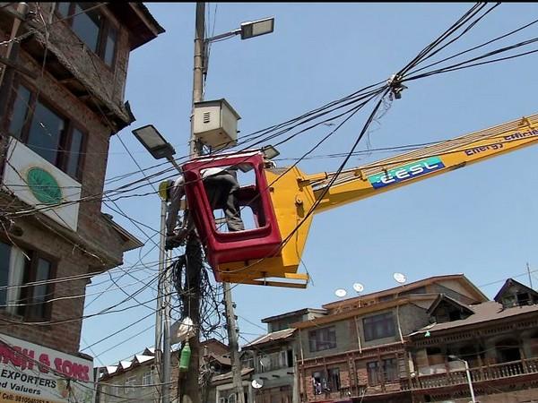 LED street lights being installed in Srinagar. Photo/ANI