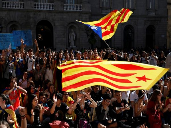 Students wave Catalan flags on Thursday during a protest on Thursday