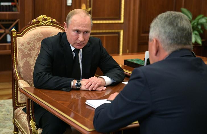 Russian President Vladimir Putin in a meeting with Defense Minister Sergei Shoigu