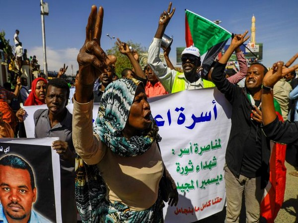 Sudanese civilians celebrate after the sentencing of 29 members of the national intelligence service to death by hanging over the killing of a teacher here on Monday.