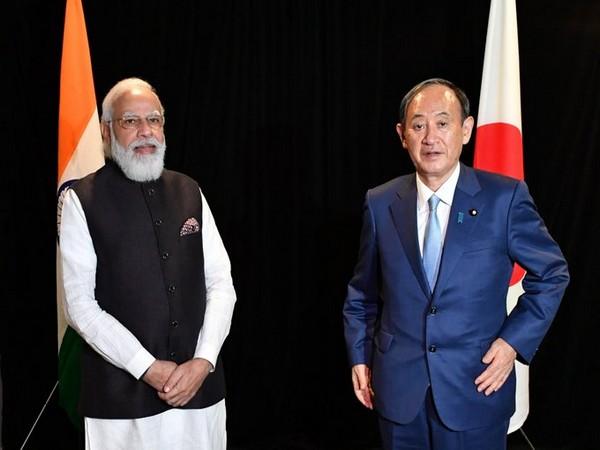 Prime Minister Narendra Modi with his Japanese counterpart Yoshihide Suga in Washington on Thursday. (Photo: Twitter/PMO)