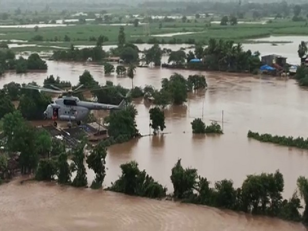 IAF helicopter rescuing people stranded in floods in Surat. Photo/ANI