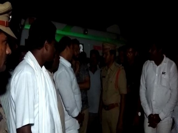 Police officials and family of the missing person at the spot of the accident in Suryapet. Photo/ANI