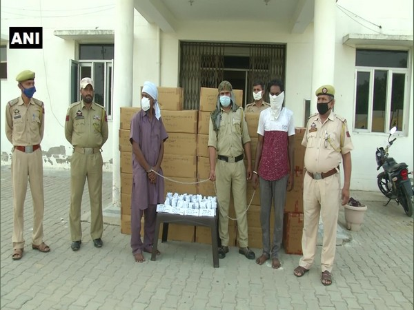 Police line up with the suspects and the busted drugs in Samba, Jammu and Kashmir.