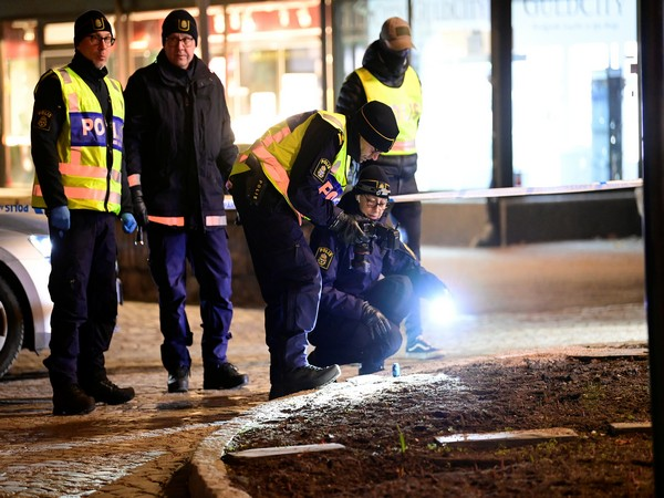 Police forensics team members conducting an investigation at the knife attack site. (Photo credit: Reuters)