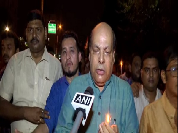 TMC leader Omprakash Mishra talking to ANI during the candle march on Monday. Photo/ANI