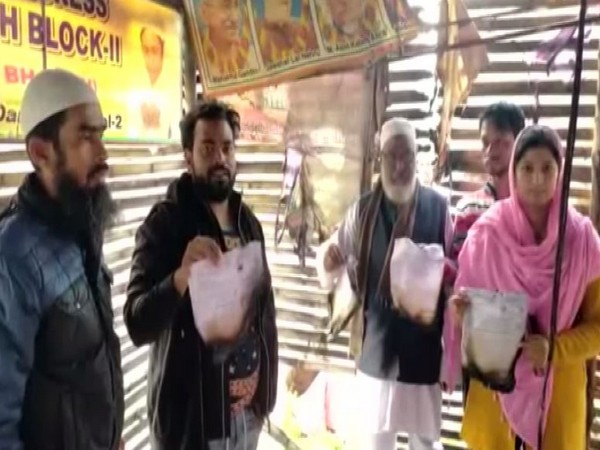 TMC workers and Councillor Mohammad Hamid Ansari showing the damage done by the fire at the TMC office in Asansol on Saturday. Photo/ANI