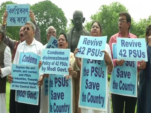 MPs from Trinamool Congress holding protest in front of Gandhi statue in Parliament over disinvestment in Public sector undertakings. (Photo/ANI)