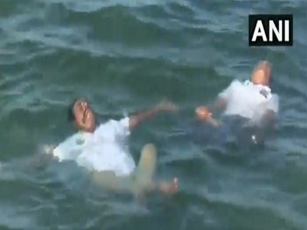People were seen practicing yoga asanas in Palk Strait here on Sunday. (Photo/ANI)