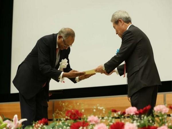 Srinivasan receiving the award in Tokyo on Wednesday