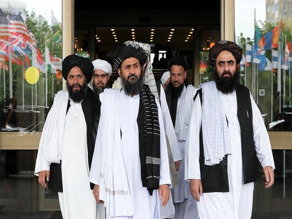 Members of a Taliban delegation, led by chief negotiator Mullah Abdul Ghani Baradar (C, front), leave after peace talks with Afghan senior politicians in Moscow, Russia, on May 30