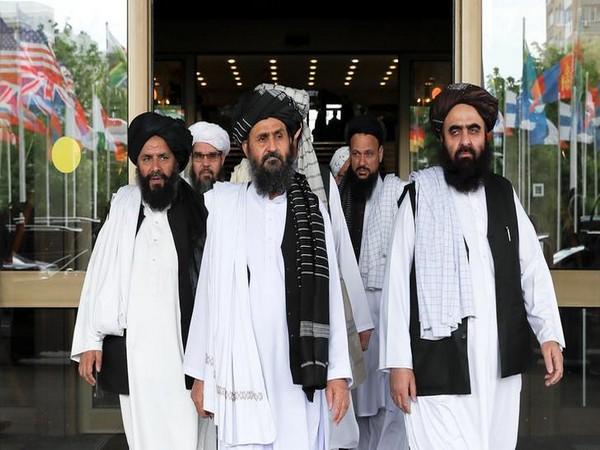 Taliban leader Mullah Baradar (Centre front row, file photo)