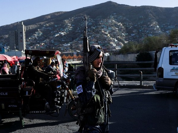 A Taliban fighter stands on a street in Kabul. (Photo Credit - Reuters)