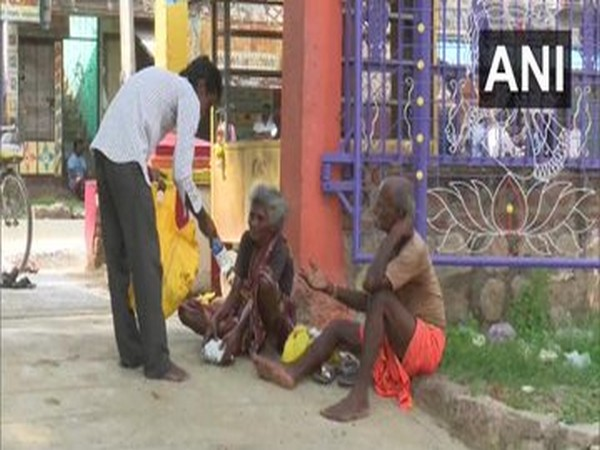 Tamilasaran, feeding the needy in Madurai. Photo/ANI