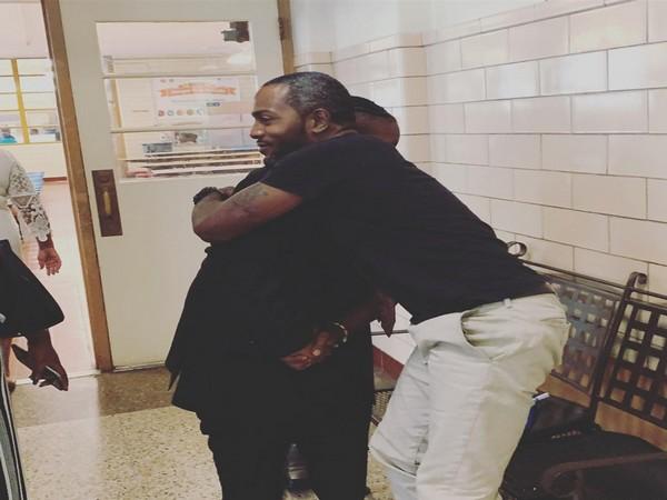 Vohn Lewis hugging his student (Image Courtesy: Facebook- Bradley Cook Kopelove)