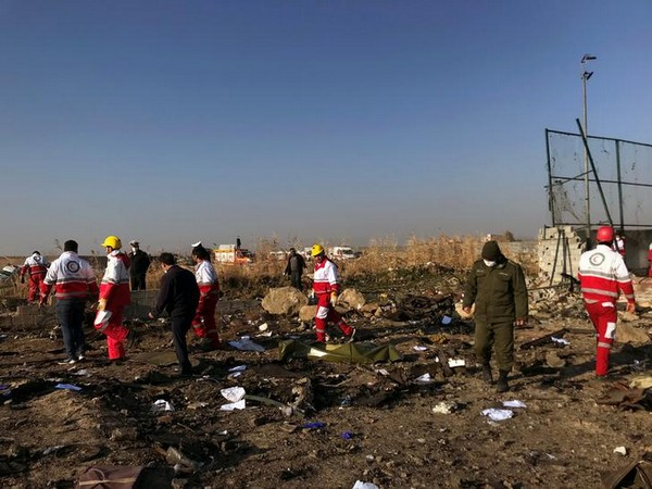 Rescue personnel at the site where a Ukraine International Airlines plane crashed near Tehran airport on Wednesday