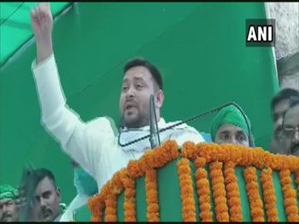 RJD leader Tejashwi Yadav speaking at a rally in Rohtas on Monday. Photo/ANI