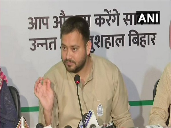 RJD leader Tejashwi Yadav addressing a press conference in Patna on Friday.