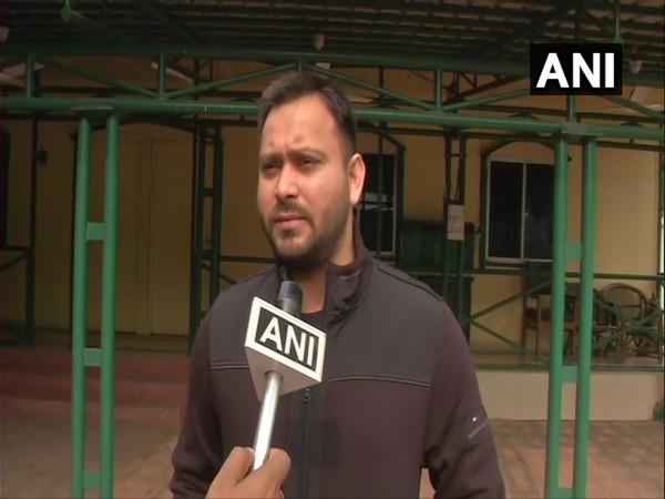 RJD leader Tejashwi Yadav speaking to ANI in Ranchi on Monday. (Photo/ANI)