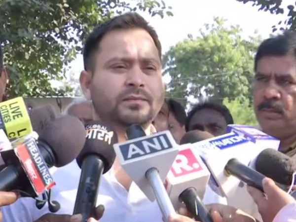 RJD leader Tejashwi Yadav speaking to reporters in Patna on Tuesday. Photo/ANI