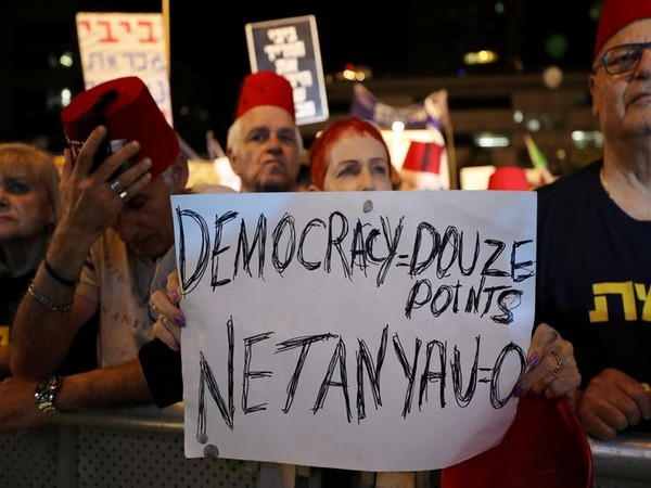 Israelis hold a demonstration in Tel Aviv, Israel on Saturday