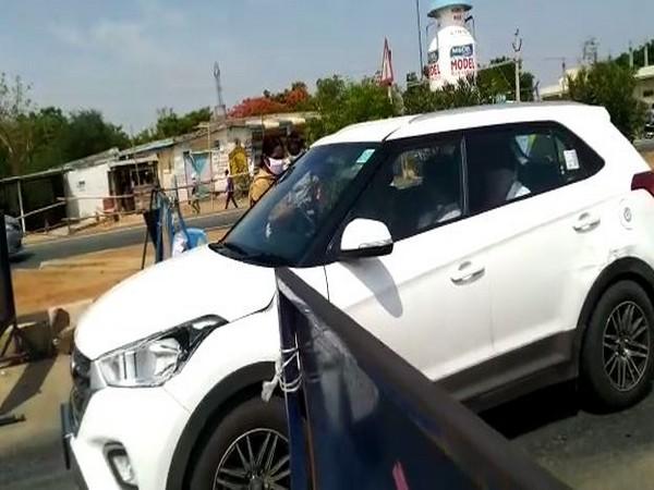 Vehicles from Telangana are being stopped at Garikapadu checkpost. Photo/ANI
