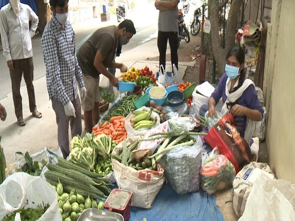 Woman selling vegetable after losing job at MNC in Hyderabad. Photo/ANI