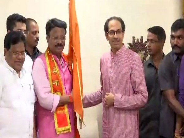 Former Congress MLA Dileep Mane with Shiv Sena president Uddhav Thackeray after joining the party in Mumbai on Wednesday. (Photo/ANI)