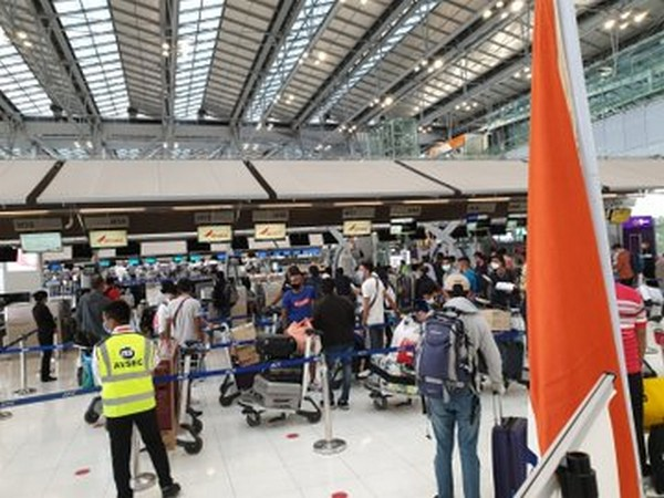 Passengers of Air India flight slated for New Delhi at an airport in Thailand