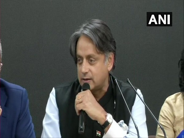 AIPC chairman Shashi Tharoor speaking to reporters in New Delhi on Sunday.
