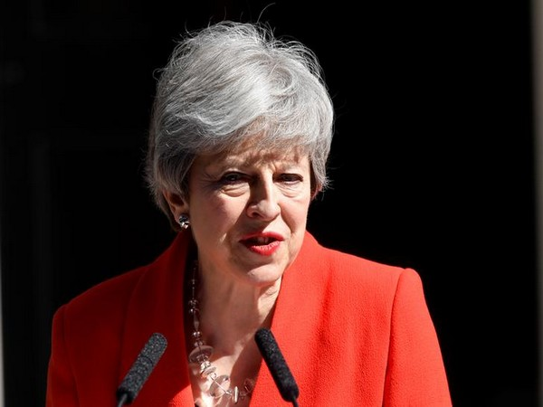 British Prime Minister Theresa May speaking to reporters in London on Friday.