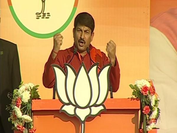 Delhi unit BJP president Manoj Tiwari speaking at an election rally on Monday in New Delhi. Photo/ANI