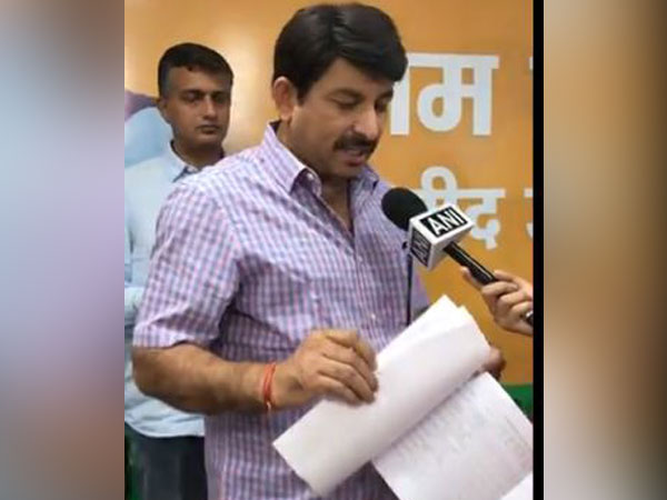 Delhi BJP chief Manoj Tiwari speaking to ANI on Sunday. Photo/ANI
