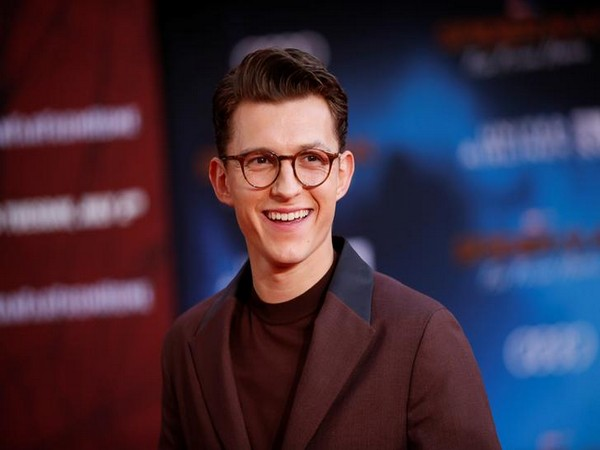 Tom Holland poses at the World Premiere of Marvel Studios' 'Spider-man: Far From Home' in Los Angeles