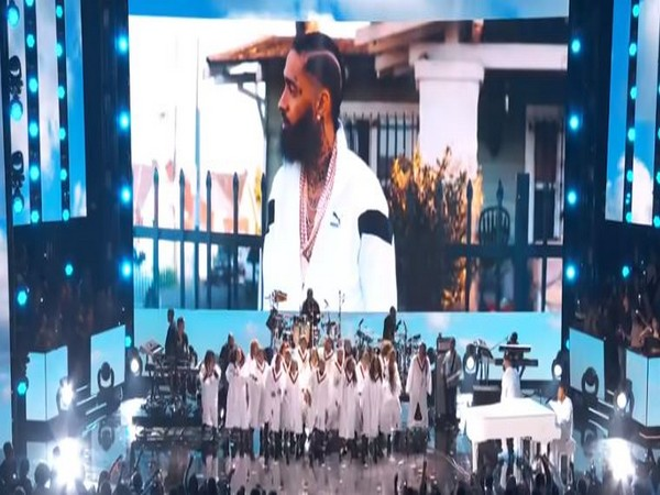 A still from the tribute performance by John Legend, DJ Khaled and more to Nipsey Hussle at 2020 Grammys
