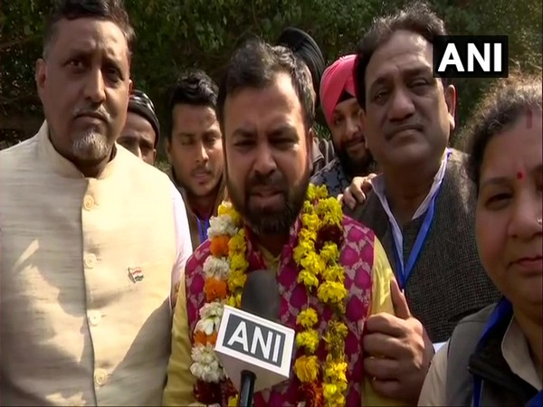 AAP's Akhilesh Pati Tripathi after winning the Model Town constituency here on Tuesday.