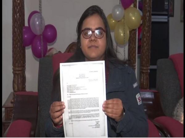 Divyangi Tripathi with the formal invitation