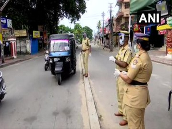 Thiruvananthapuram Police checking IDs of people as they move about for their daily chores amid citywide lockdown.