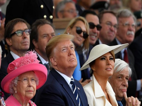 Queen Elizabeth II, US President Donald Trump and first lady Melania Trump attend an event to commemorate the 75th anniversary of D-Day, in Portsmouth, Britain, on Wednesday